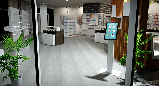 A kiosk equipped with innovative technology stands in a spacious pharmacy.